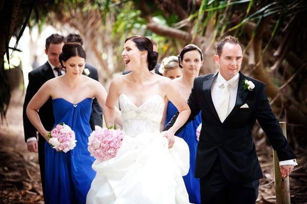 Wedding party with blue bridesmaids