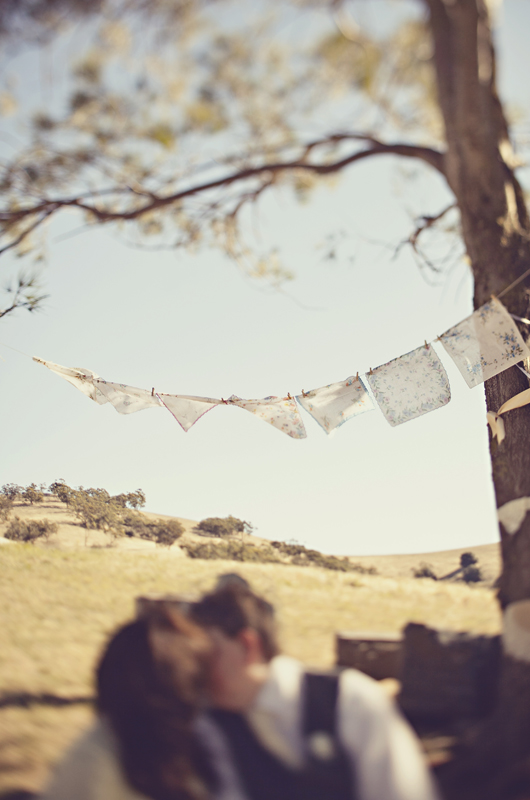 Vintage styled engagement photo - bride and groom kissing