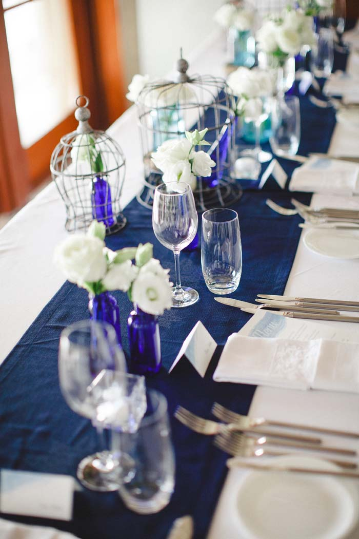 Dining table with blue top runner